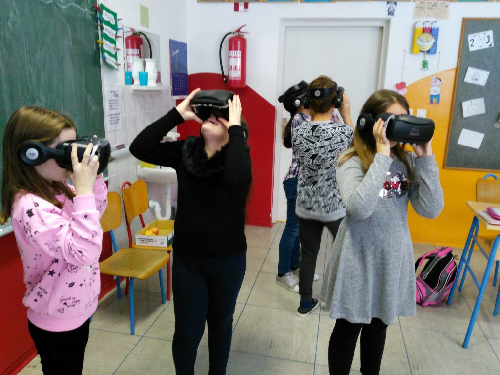 A group of students discovering and using VR glasses for the first time