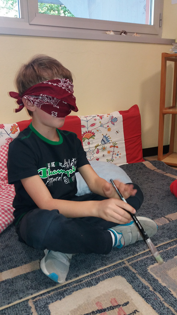 A student being blindfolded